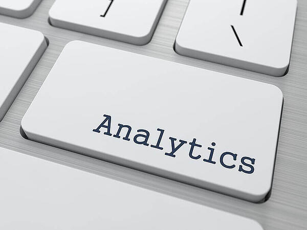 Analytics Concept. Button on Modern Computer Keyboard with Word Analytics on It.